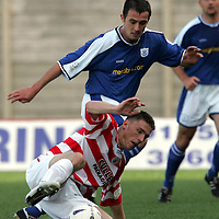 Hamilton Accies v St Johnstone...4.09.04<br />David Hamilton is tackled by David Hannah<br /><br />Picture by Graeme Hart.<br />Copyright Perthshire Picture Agency<br />Tel: 01738 623350  Mobile: 07990 594431