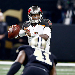 Dec 24, 2016; New Orleans, LA, USA; Tampa Bay Buccaneers quarterback Jameis Winston (3) looks to throw against the New Orleans Saints during the first quarter of a game at the Mercedes-Benz Superdome. Mandatory Credit: Derick E. Hingle-USA TODAY Sports