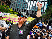 "SEOUL, SOUTH KOREA: A South Korean man leads chants against the Japanese embassy in Seoul during the Wednesday protest. The Wednesday protests have been taking place since January 1992. Protesters want the Japanese government to apologize for the forced sexual enslavement of up to 400,000 Asian women during World War II. The women, euphemistically called ""Comfort Women"" were drawn from territories Japan conquered during the war and many came from Korea, which was a Japanese colony in the years before and during the war. The ""comfort women"" issue is still a source of anger of many people in northeast Asian areas like South Korea, Manchuria and some parts of China.        PHOTO BY JACK KURTZ   <br /> Wednesday Demonstration demanding Japan to redress the Comfort Women problems"