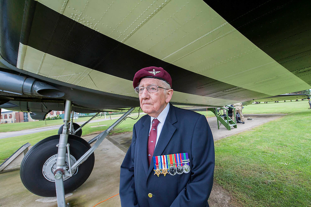 Tom Hughes, 9 Para. under a dakota with d-day markings - he was not on the d-day drop due to injury but did jump at Arnhem later . Veterans of the Parachute Regiment at the time of D Day, in the second world war, visit 16 Air Assault Brigade who will be carrying out a drop to commemorate the 70th anniversary next week. Colchester, UK.