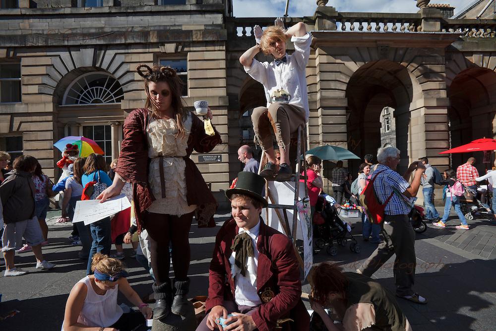 Fringe performers promote their shows on Edinburgh's Royal Mile, during the Edinburgh Festival