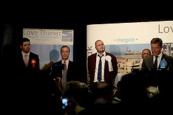 """© London News Pictures. """"Looking for Nigel"""". A body of work by photographer Mary Turner, studying UKIP leader Nigel Farage and his followers throughout the 2015 election campaign. PICTURE SHOWS - UKIP leader Nigel Farage loses the South Thanet election to Conservative candidate Craig Mackinlay on May 8th 2015. Pictured (l-r) are Labour Candidate Will Scobie, Nigel Farage, Al Murray, the Pub Landlord, Independent candidate Dean McCastree and winning Conservative candidate Craig Mackinlay. Farage was booed and hissed by the audience as his result was read out. . Photo credit: Mary Turner/LNP **PLEASE CALL TO ARRANGE FEE** **More images available on request**"""