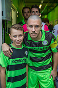 Forest Green Rovers Liam Noble(15) with mascot Rory Bashford during the Vanarama National League match between Forest Green Rovers and Dagenham and Redbridge at the New Lawn, Forest Green, United Kingdom on 29 October 2016. Photo by Shane Healey.