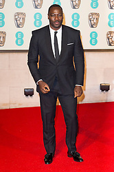 © Licensed to London News Pictures. 14/02/2016. London, UK. ADEWALE AKINNUOYE AGBAJE arrives on the red carpet for the EE British Academy Film Awards 2016 after party held at Grosvenor House . London, UK. Photo credit: Ray Tang/LNPPhoto credit: Ray Tang/LNP