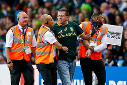 A pitch invader wearing a South Africa shirt is removed from the stadium - Mandatory byline: Rogan Thomson/JMP - 07966 386802 - 26/09/2015 - RUGBY UNION - Villa Park - Birmingham, England - South Africa v Samoa - Rugby World Cup 2015 Pool B.