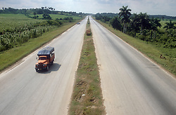 Lorry travelling along motorway in Cuba,