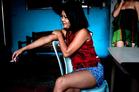 These are portraits I made of a few of the girls from a small intimate bar in Olongapo City,adjacent to Subic,formerly the US' largest military installation in the Pacific.