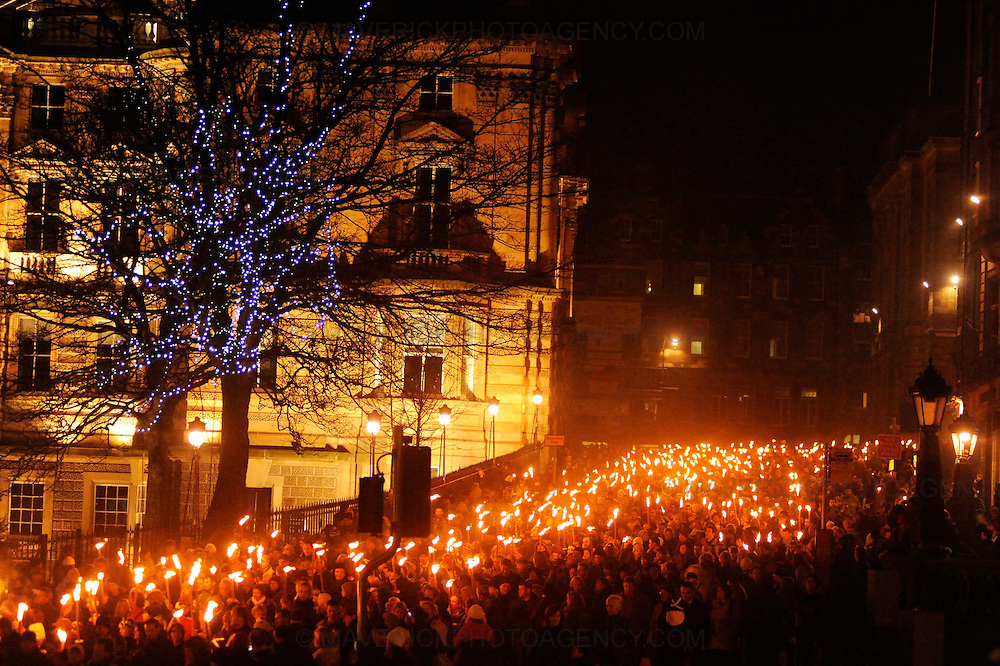 Edinburgh kicked off its Hogmanay celebrations with thousands of people joining in a torchlight procession creating a dramatic ?river of fire? through the city centre, Edinburgh, Scotland, UK - 29th December 2008.  The revellers gathered for the event finale for the burning of a huge Lion Rampant on top of Calton Hill.