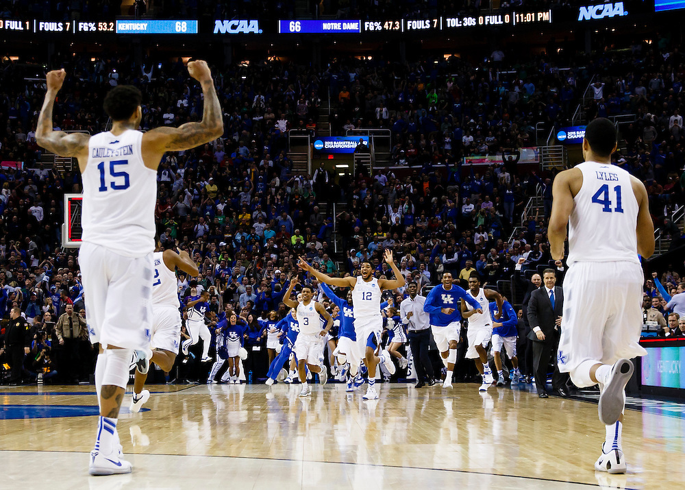 Mar 28, 2015; Cleveland, OH, USA; Kentucky Wildcats forward Willie Cauley-Stein (15) and forward Trey Lyles (41) celebrates as forward Karl-Anthony Towns (12) leads the team onto the courts after defeating the Notre Dame Fighting Irish in the finals of the midwest regional of the 2015 NCAA Tournament at Quicken Loans Arena. Mandatory Credit: Rick Osentoski-USA TODAY Sports