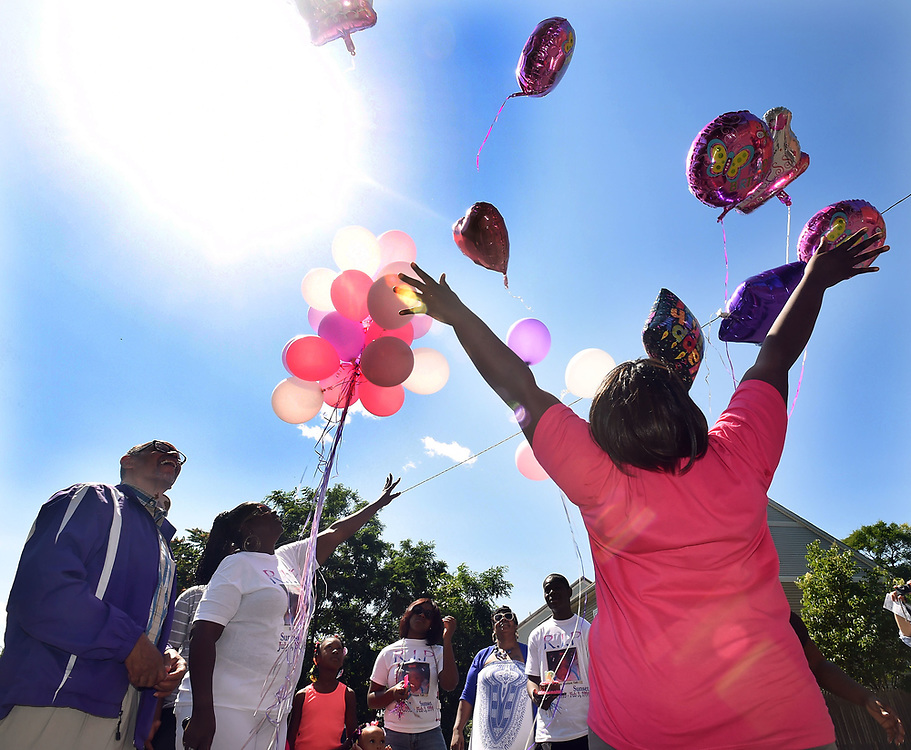 (Mara Lavitt &mdash; New Haven Register) <br /> July 5, 2014 New Haven<br /> Danielle Taft was seven months old when she was killed by a bullet sprayed into her home on Orchard St. on Feb. 3, 1994. A memorial celebration in her honor was held next to her former home on the day of what would have been her 21st birthday. Bishop Theodore Brooks of Beulah Heights Pentecostal Church, Danielle's mother Shirley Troutman and cousin Angel Ogman, all of New Haven, watch as balloons are released.<br /> mlavitt@newhavenregister.com