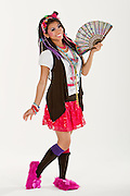 Harajuku girl posing with a hand fan