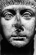 Close up of an ancient Greek sculpture with its nose missing