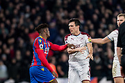 Burnley (4) Jack Cork, Burnley (6) Ben Mee, Crystal Palace #11 Wilfried Zaha, gestures  and arguments between players during the Premier League match between Crystal Palace and Burnley at Selhurst Park, London, England on 13 January 2018. Photo by Sebastian Frej.