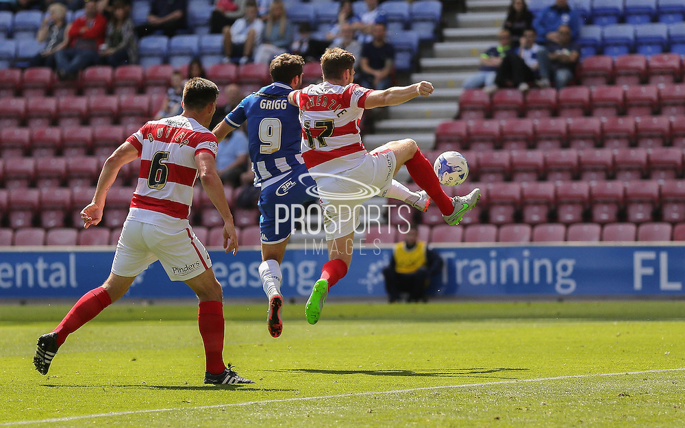 Grigg & McKenzie during the Sky Bet League 1 match between Wigan Athletic and Doncaster Rovers at the DW Stadium, Wigan, England on 16 August 2015. Photo by Simon Davies.