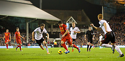LONDON, ENGLAND - Wednesday, February 12, 2014: Liverpool's Luis Suarez in action against Fulham during the Premiership match at Craven Cottage. (Pic by David Rawcliffe/Propaganda)