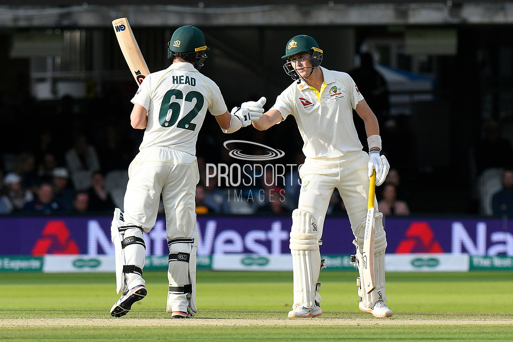 50 - Marnus Labuschagne of Australia is congratulated by Travis Head of Australia as he celebrates scoring a half century during the International Test Match 2019 match between England and Australia at Lord's Cricket Ground, St John's Wood, United Kingdom on 18 August 2019.