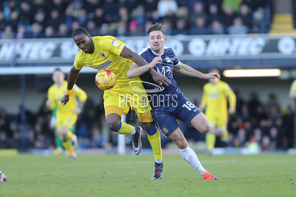 AFC Wimbledon striker Tom Elliott (9) battles for possession with Southend United defender Ryan Leonard (18) during the EFL Sky Bet League 1 match between Southend United and AFC Wimbledon at Roots Hall, Southend, England on 26 December 2016. Photo by Stuart Butcher.