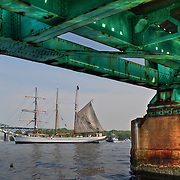 Tall ship Gazela viewed from under the Sarah Mildred Long Bridge,  as it passes in front of the Piscataqua River Bridge (I-95)