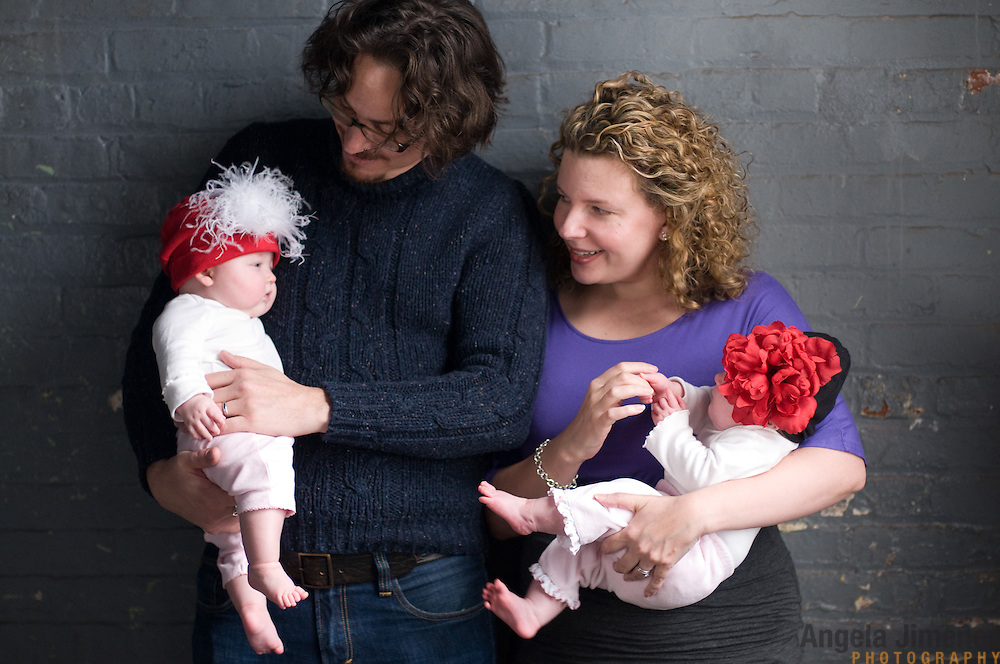 Karen Grenke and her family are photographed in a studio family portrait at the Brooklyn Arts Exchange for the annual holiday photo shoot fundraiser in Brooklyn, New York on November 13, 2011. ..Photo by Angela Jimenez .www.angelajimenezphotography.com