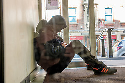 A homeless person asleep in a doorway