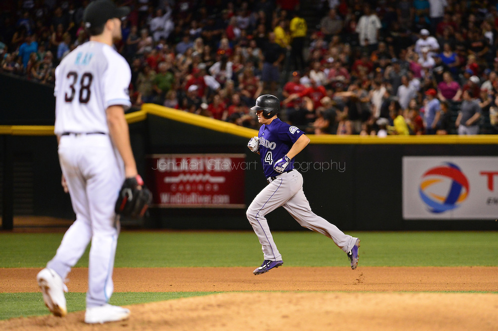 Apr 29, 2016; Phoenix, AZ, USA; Colorado Rockies catcher Nick Hundley (4) runs the bases after hitting a solo home run during the fourth inning against Arizona Diamondbacks starting pitcher Robbie Ray (38) at Chase Field. Mandatory Credit: Jennifer Stewart-USA TODAY Sports
