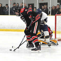 TORONTO, ON  - APR 10,  2018: Ontario Junior Hockey League, South West Conference Championship Series. Game seven of the best of seven series between Georgetown Raiders and the Toronto Patriots. Jacob Payette #6 of the Georgetown Raiders battles for the puck with Oliver Benwell #14 of the Toronto Patriots during the third period.<br /> (Photo by Andy Corneau / OJHL Images)