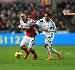 Swansea City's Jonathan de Guzman tries to tackle Fulham's Dimitar Berbatov - Photo mandatory by-line: Alex James/JMP - Tel: Mobile: 07966 386802 28/01/2014 - SPORT - FOOTBALL - Liberty Stadium - Swansea - Swansea City v Fulham - Barclays Premier League