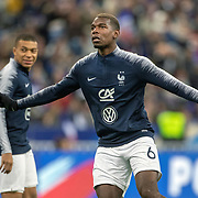PARIS, FRANCE - March 25:  Paul Pogba #6 of France and Kylian Mbappé #10 of France warming up with team-mates before the France V Iceland, 2020 European Championship Qualifying, Group Stage at  Stade de France on March 25th 2019 in Paris, France (Photo by Tim Clayton/Corbis via Getty Images)
