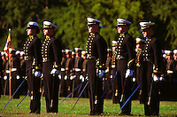 "Annapolis, Maryland--Midshipmen at the United States Naval Academy stand at attention durring a Color Parade.The Color Parade is the oldest special parade at the U.S. Naval Academy, a tradition that began in 1871. In its last full dress parade, the company that has excelled academically, athletically and professionally throughout the year is honored by receiving the ""colors"" (company flags) of last year's winners."