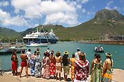World Discoverer, ship greeters, Hakahau, Mt. Otave, Ua Pou, Marquesas, French Polynesia<br />