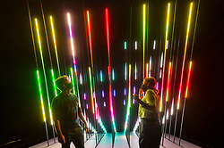 "© Licensed to London News Pictures. 28/07/2020. CITY, UK.  Staff members pose in front ""CORE"", 2019, by 1024 Architecture, an audio visual LED installation.  Preview of ""Electronic: From Kraftwerk to The Chemical Brothers"" at the Design Museum in Kensington which is reopening after coronavirus lockdown.  The new exhibition explores the hypnotic world of electronic music, from its origins to its futuristic dreams.  The show runs 31 July 2020 – 14 February 2021 with visitors required to adhere to strict social distancing guidelines.  Photo credit: Stephen Chung/LNP"