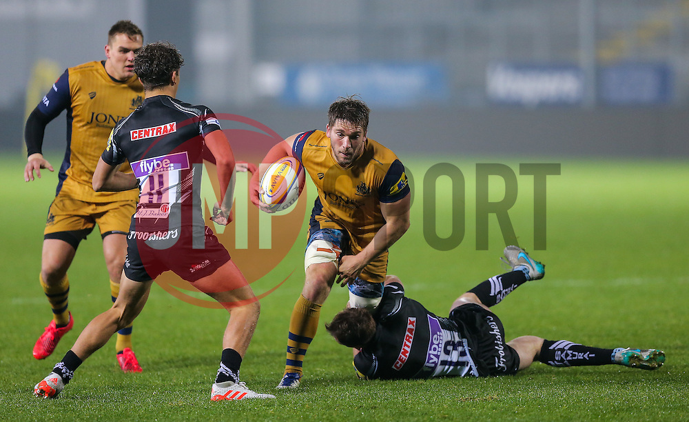 Nick Fenton-Wells (capt) of Bristol United is tackled by Max Bodilly of Exeter Braves - Rogan Thomson/JMP - 24/10/2016 - RUGBY UNION - Sandy Park - Exeter, England - Exeter Braves v Bristol United - Reserve Team Friendly.