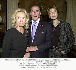 MRS KIKI  THOLSTRUP, Actor ROGER MOORE and his daughter MISS DEBORAH MOORE, at a reception in London on 8th November 2001.		OUB 122