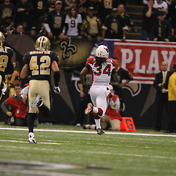 16 January 2010: Arizona Cardinals running back Tim Hightower (34) runs for a touchdown against the New Orleans Saints during the first half of the 2010 NFC Divisional Playoff game at the Louisiana Superdome in New Orleans, Louisiana.