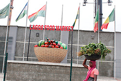 May 4, 2020, Lagos, Nigeria: A woman without facemask walks past the fence of Mile 12 Food Market in Lagos, Nigeria on Monday, May, 4 2020. In order to cushion the hardship of Coronavirus (COVID-19) pandemic lockdown, government has relaxed its rules by allowing people to move and open business in the day time, imposed curfew form 8PM -6AM and made it compulsory for everybody to wear facemask in public places from Monday, May 4, 2020. Photo by Adekunle Ajayi  (Credit Image: © Adekunle Ajayi/NurPhoto via ZUMA Press)