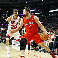 24 March 2012: Toronto Raptors small forward Linas Kleiza (11) drives past Chicago Bulls shooting guard Kyle Korver (26) during the Chicago Bulls 102-101 victory in overtime over the Toronto Raptors at the United Center, Chicago, Illinois, USA.