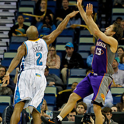 February 2, 2012; New Orleans, LA, USA; Phoenix Suns point guard Steve Nash (13) shoots over New Orleans Hornets point guard Jarrett Jack (2) during the second quarter of a game at the New Orleans Arena.   Mandatory Credit: Derick E. Hingle-US PRESSWIRE