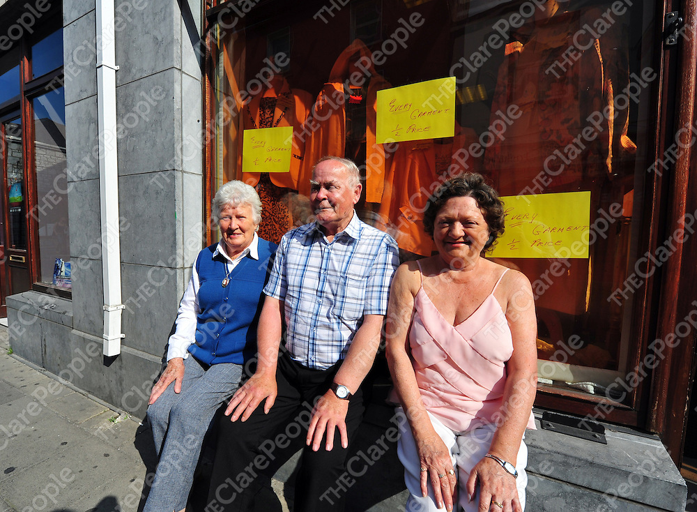 Renee Browne from Circular Road in Ennis stopping off for a quick chat on her way to Mass with Anne Pigott Mackey and Paddy Molloy&nbsp; of the Fuller figure Fashion Shop in Parnell Street who were sitting outside enjoying the  sunshine. 10am 25.06.09<br /> David Crimmins<br /> &nbsp;