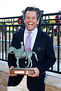 HOT SPRINGS, AR - MAY 02:  George Bolton, co-owner of #5 Nadal,  smiles after after his horse wins the 84th running of The Arkansas Derby Grade 2 at Oaklawn Racing Casino Resort on Derby Day during the Covid-19 Pandemic on May 2, 2020 in Hot Springs, Arkansas. (Photo by Wesley Hitt/Getty Images)