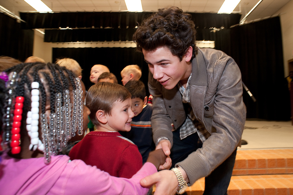 "Mark Matson For USO (12/11/09)  The USO hosted a ""Community Strong"" event at Ft. Hood, Friday December 11, 2009. Singer Nick Jonas made an appearance at Meadows Elementary School. Jonas reached out to the students and alos posed for photos with each class."