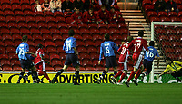 Photo: Andrew Unwin.<br />Middlesbrough v Dnipro. UEFA Cup. 03/11/2005.<br />Middlesbrough's Yakubu (L) fires home his team's first goal.