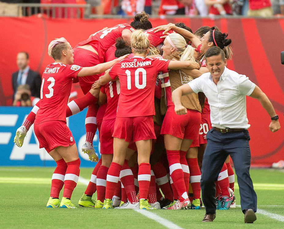 Canadian Coach, John Herdman celebrates Canada's goal in 2015 women's World Cup Soccer in Vancouver during second round action between Canada and Switzerland