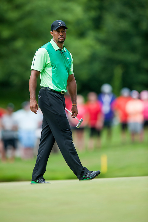 Tiger Woods surveys a putt on the 6th hole during the first round of the Quicken Loans National golf tournament on Wednesday at Congressional Country Club in Bethesda, Maryland. This marked  Woods' return to competition for the first time in three months after having surgery just a week before the Masters in April of this year.