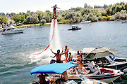 Cody Taylor of Bend shows off the Flyboard on Saturday, July 27 among the party boats at the 2013 Lamb Weston Columbia Cup.