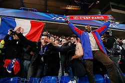 Paris Saint-Germain supporters celebrate after their side go through to the Quarter Finals on away goals after drawing the match 2-2 (3-3) - Photo mandatory by-line: Rogan Thomson/JMP - 07966 386802 - 11/03/2015 - SPORT - FOOTBALL - London, England - Stamford Bridge - Chelsea v Paris Saint-Germain - UEFA Champions League Round of 16 Second Leg.