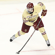 Adam Gilmour #14 of the Boston College Eagles controls the puck during The Beanpot Championship Game at TD Garden on February 10, 2014 in Boston, Massachusetts. (Photo by Elan Kawesch)