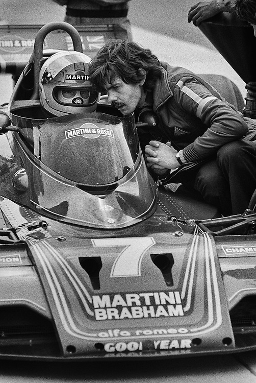 Martini-Brabham race driver John Watson works with Brabham designer Gordon Murray,  during practice for the 1979 United States Grand Prix at Watkins Glen. Watson would qualify second, but, with a light drizzle for the race, the team ordered Watson to start on Goodyear dry racing &quot;slicks&quot; on the chance that the track might dry and Watson would have a distinct advantage. The rain continued until the final  few laps. Watson would finish 12th.<br />