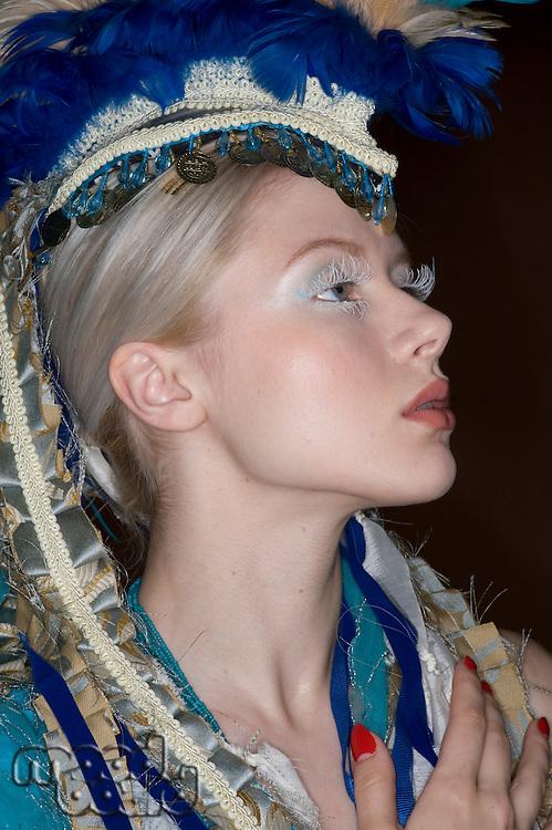 Side view fashion model wearing headgear looking away