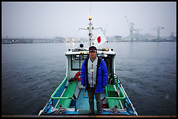 Boat captain Toshio Sato, 57, lost three of this four boats in the tsunami. His current boat Yachiyo II, he rebuilt from Yachiyo which he found washed up on a road in Shiogama City, his wife also witnessed their neighbours dying Saturday February 4, 2012. Photo By Andrew Parsons/i-Images