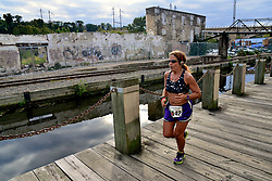 Around 200 came out to run the inaugural 4 mile Tomato Trot over the Manayunk Towpath. ..Cheryl Scher is leading her age group as she heads for the finish.